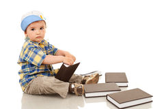 Little boy playing with some books Stock Photos