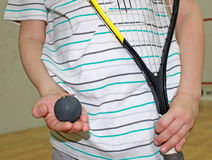 Little boy playing squash. Little boy holding a racket and ball Squash Royalty Free Stock Photography