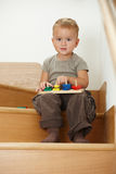 Little boy playing on stairs Stock Images