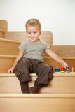 Little boy playing on stairs Stock Photo