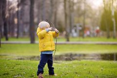 Little boy playing with sticks during stroll in the park. At spring, summer or autumn day. Active family time on nature. Hiking with little kids Stock Photography