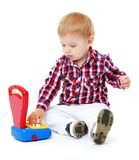 Little boy playing in the store. Royalty Free Stock Photography