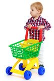 Little boy playing in the store. Early years learning a happy childhood concept.Isolated on white background Stock Images