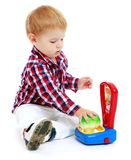 Little boy playing in the store. Royalty Free Stock Image
