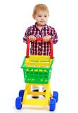 Little boy playing in the store. Early years learning a happy childhood concept.Isolated on white background Royalty Free Stock Photo