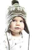 Little child in winter cap. Little boy playing in studio royalty free stock image