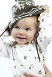 Playing with winter cap. Little boy playing in studio stock photo