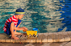 Little boy playing in swimming pool at beach Royalty Free Stock Image