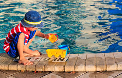 Little boy playing in swimming pool at beach Stock Images