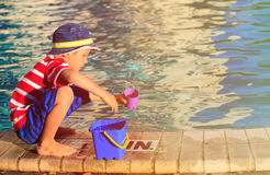 Little boy playing in swimming pool at beach Royalty Free Stock Photography