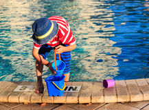 Little boy playing in swimming pool at beach Stock Photography