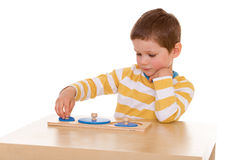 Little boy playing at the table stock photography
