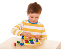 Little boy playing at the table Royalty Free Stock Photography