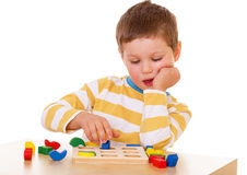 Little boy playing at the table Stock Images
