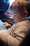 Little boy playing on a tablet computer Royalty Free Stock Photo
