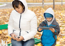 Little boy playing with a tablet computer Stock Image