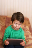 Little boy playing on tablet Royalty Free Stock Photo