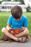 Little boy playing on tablet Stock Images