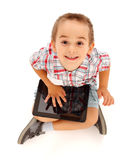 Little boy playing on tablet pc Stock Photography