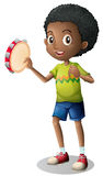 Little boy playing tambourine Royalty Free Stock Image