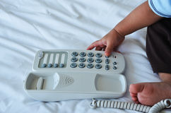 Little boy playing with telephone Stock Photography