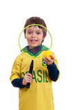 Little boy playing with tennis racket and ball Royalty Free Stock Photos