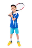 Little boy playing tennis racket and tennis ball in hand royalty free stock photo