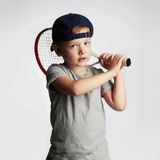Little Boy Playing Tennis. Sport kids.Child with Tennis Racket Royalty Free Stock Images