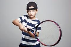 Little Boy Playing Tennis. Sport kids. stock photo