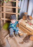 Little boy is playing with the tools of a carpenter. Royalty Free Stock Photo