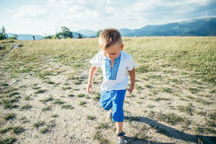 Little boy playing on the top of the mountain Stock Photography