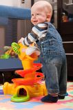 Little boy is playing with toy Stock Photography