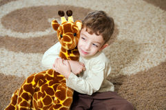 Little boy playing with toy . Beautiful little boy with toy royalty free stock photo
