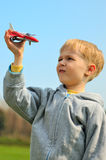 Little boy is playing with toy airplane Stock Images