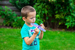 Little boy playing with toy airplane Stock Photo
