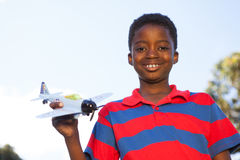 Little boy playing with toy airplane Royalty Free Stock Images