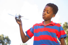 Little boy playing with toy airplane Royalty Free Stock Photo