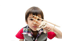 Little boy playing with a toy airplane. on white backgr Stock Photography