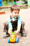 Little boy playing in the toy car. A little boy smiling and playing in the toy car in the children Stock Photography