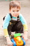 Little boy playing in the toy car. A little boy smiling and playing in the toy car in the children Stock Photos