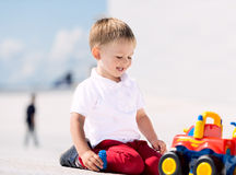 Little boy playing with toy car horizontal Royalty Free Stock Image
