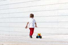 Little boy playing with toy car no face Stock Photography