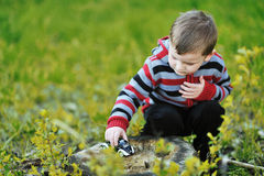 Little boy playing with toy car. Outdoor Royalty Free Stock Images