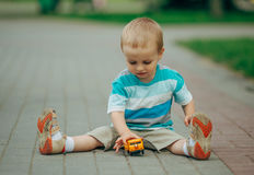 Little boy playing with toy car Royalty Free Stock Photography