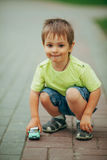 Little boy playing with toy car royalty free stock images