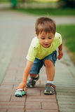 Little boy playing with toy car royalty free stock image