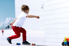 Little boy playing with toy car running Stock Photo