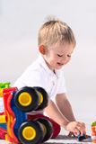 Little boy playing with toy car vertical Royalty Free Stock Photo