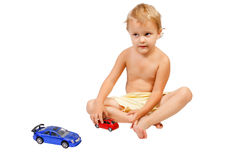 Little boy playing with toy cars Royalty Free Stock Photos