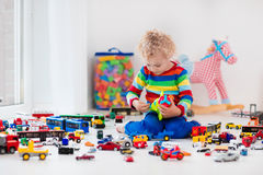 Little boy playing with toy cars Royalty Free Stock Photo
